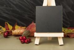 Autumn, mini blackboard chalkboard and maple leaves. Grey backgroud, copy space. Autumn, mini blackboard chalkboard and maple leaves. Grey backgroud royalty free stock image