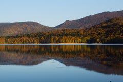 Autumn mirror reflection in lake Pasanauri, Georgia Royalty Free Stock Photo