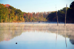 Autumn Mist. A beautiful autumn morning where steam is coming up from the water Stock Photo