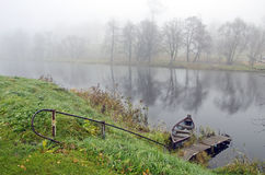 Autumn mist and boat in river Royalty Free Stock Photo
