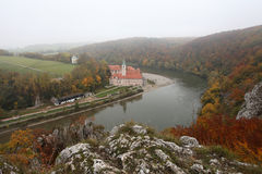 Autumn mist over danube river. Autumn misty view over monastery in danube river Royalty Free Stock Image
