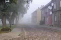 Autumn mist urban Stock Photos