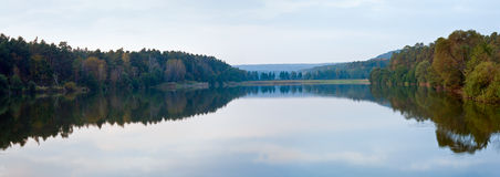 Autumn misty evening lake panorama. Stock Images