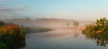 Autumn misty morning on the lake stock photo