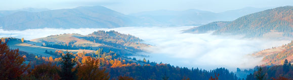 Autumn misty morning mountain panorama Stock Photo