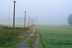 Autumn misty path in the countryside of South Bohemia Stock Photos