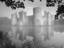 Autumn misty sunrise on Bodiam Castle, East Sussex, UK. Bodiam, UK - October 2018: Autumn misty sunrise on Bodiam Castle, East Sussex, UK royalty free stock photo