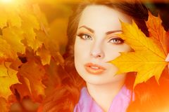 Autumn model, bright make up. woman on background fall landscape royalty free stock photography