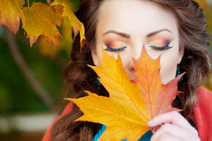Autumn model, bright make up. woman on background fall landscape Stock Photography