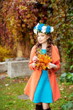 Autumn model, bright make up. woman on background fall landscape Royalty Free Stock Photo