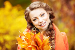 Autumn model, bright make up. woman on background fall landscape Royalty Free Stock Image