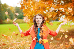 Autumn model, bright make up. woman on background fall landscape Stock Photo
