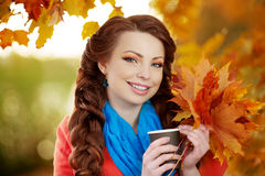 Autumn model, bright make up. woman on background fall landscape Stock Image