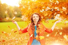 Autumn model, bright make up. woman on background fall landscape Stock Images