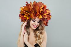 Autumn model woman. Pretty blonde girl in autumn leaves wreath.  stock image