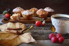 Autumn mood: apple muffins and coffee. Autumn tea drink: apple muffins and cup of coffee Royalty Free Stock Photo