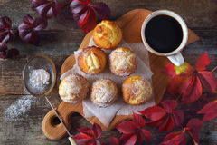 Autumn mood: apple muffins and coffee. Autumn tea drink: sweet muffins and cup of coffee. Top view Royalty Free Stock Image