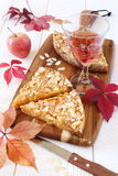 Autumn mood: apple tart, colorful leaves and a wineglass Stock Photography