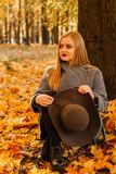 Autumn mood. Portrait of a girl in the park royalty free stock image