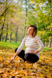 Autumn mood - pregnant woman outdoor Stock Photos