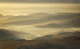 Autumn morning with fog and sun rising over a moun Royalty Free Stock Photography