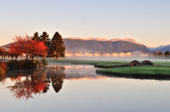 Autumn morning in golf course. Stone bridge over creek on golf course with autumn colors Royalty Free Stock Image
