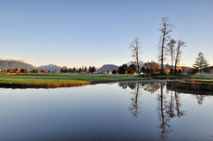 Autumn morning in golf course. Meadow gardens golf course with golden ears mountain in background Stock Photo