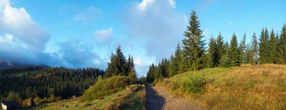 Autumn morning in mountain. Autumn beginning morning in Carpathian mountain, Ukraine. Seven shots stitch image. With moon under trees Stock Image