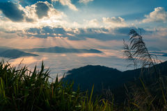 Autumn morning mountain view with sunbeam and haze Stock Photography