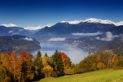 Autumn morning view on Lake Millstatt in Austria. Sunny autumn morning view on Lake Millstatt in Austria, Carinthia. With golden, orange and red trees, small Royalty Free Stock Photos