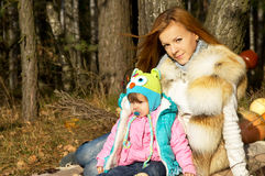 Autumn mother with baby on nature Royalty Free Stock Photo