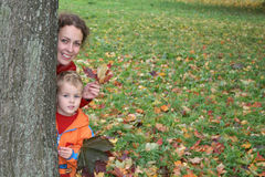 Autumn mother with child Stock Image