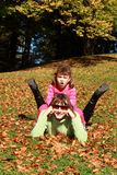 Autumn: mother and child fun Royalty Free Stock Photo