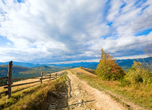 Autumn mountain and country road Stock Photos
