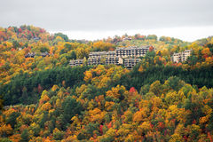 Autumn mountain forest with hotel buildings on top Royalty Free Stock Image