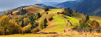 Autumn mountain hills in the Alps Stock Images