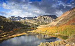 Autumn at a mountain lake Stock Photos
