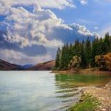 Autumn Mountain lake in coniferous forest Stock Photos