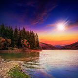 Autumn Mountain lake in coniferous forest at sunset Royalty Free Stock Photo
