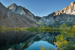 Autumn Mountain Lake. Convict Lake in the autumn with yellow aspen trees and reflection of mountains Royalty Free Stock Photo