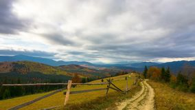 Autumn. Mountain Landscape with a Dirt Road