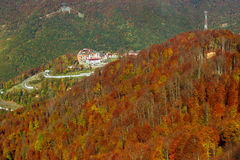 Autumn mountain landscape, Krasnaya Polyana, Sochi. Ski resort with hotel and tourist infrastructure among the mountain massif. Autumn Caucasus mountain Royalty Free Stock Image