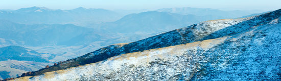 Autumn  mountain panorama with first winter snow Stock Photo