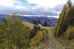 Autumn in mountain road Royalty Free Stock Photo