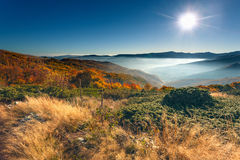 Autumn mountain scenery against rising sun Royalty Free Stock Image