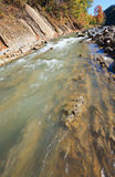 Autumn mountain stony river Royalty Free Stock Images