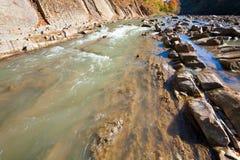 Autumn mountain stony river Stock Photos