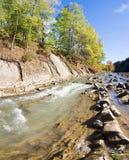 Autumn mountain stony river Stock Images