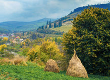 Autumn mountain view with stacks of hay Royalty Free Stock Image