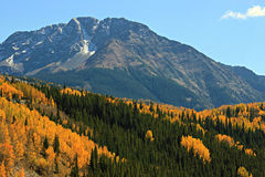 Autumn Mountains. The many contrasting layers of Autumn Aspens and Evergreens decorate the slopes of the San Juan Mountain range in Southwest Colorado Stock Images
